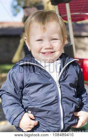 Portrait Of A Sweet One Year Old Baby Girl In A Park