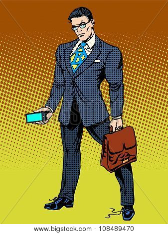 Stern businessman with smartphone