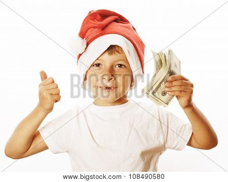 little cute boy in santas red hat isolated with cash american dollars thumbs up happy kid