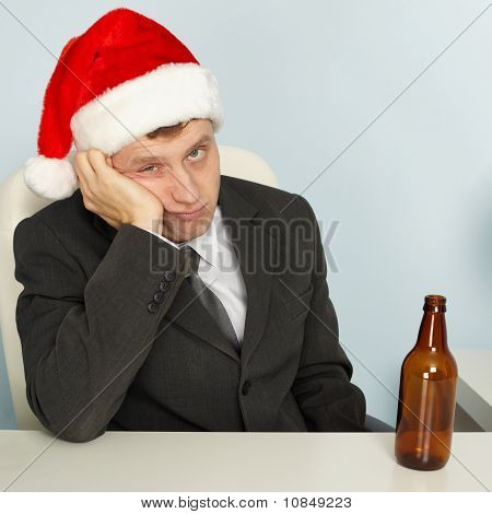 Sad Man Suffering From Hangover After Christmas