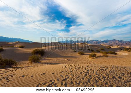 Sand dunes of the Death Valley in evening shadows