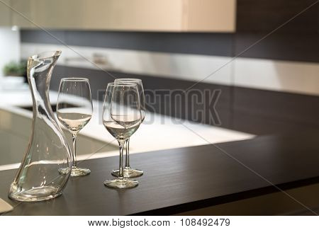 Wine Glasses And Carafe In Kitchen