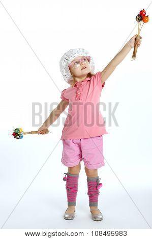 little beautiful girl with maracas