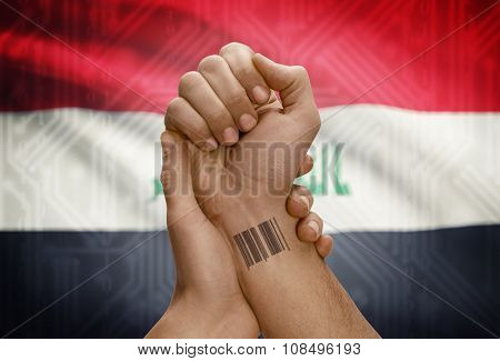 Barcode Id Number On Wrist Of Dark Skinned Person And National Flag On Background - Iraq