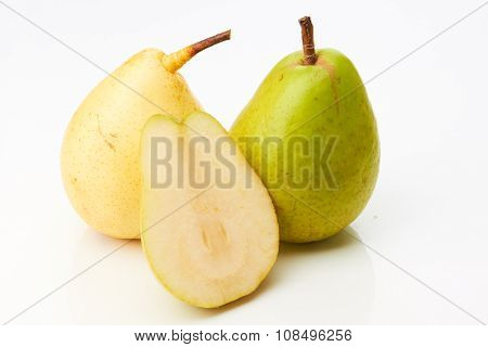 Green and yellow pear with half