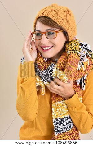 Portrait of trendy girl with eyeglasses and winter accessories