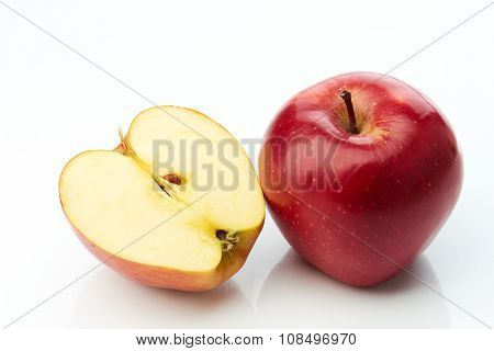 Red apple and half isolated on white