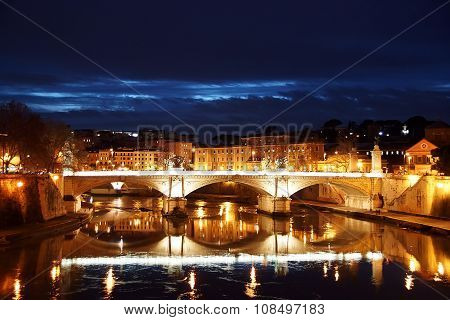 Night view of Tiber and bridge Vittorio Emanuelle II. Rome
