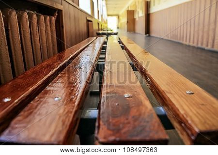 Modern public school, large spacious empty corridor school bench