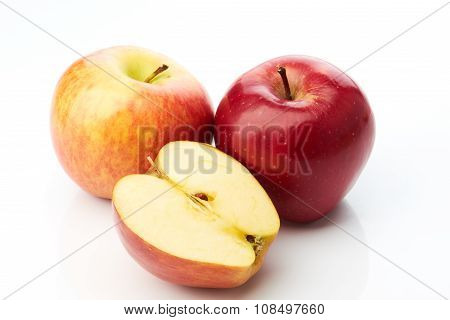 Two apples and half isolated on white