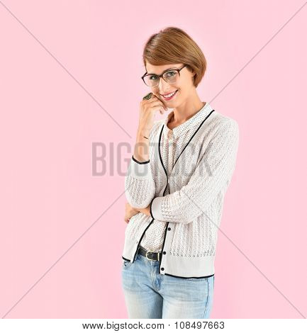 Trendy girl with eyeglasses, pink background