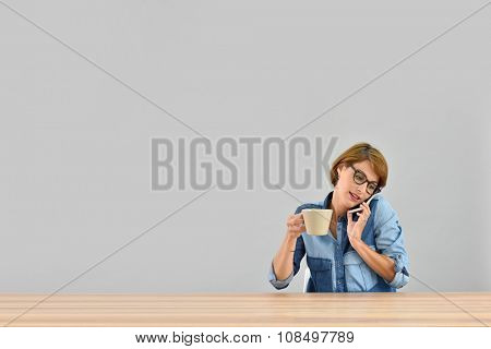 Woman with eyeglasses talking on mobile phone, isolated