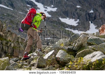 Young woman is hiking in forests of Siberia Russia