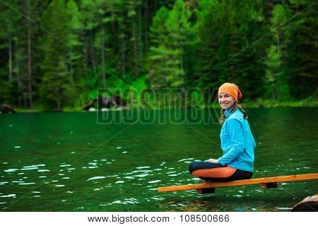 Woman is doing yoga excercises in Altai mountains