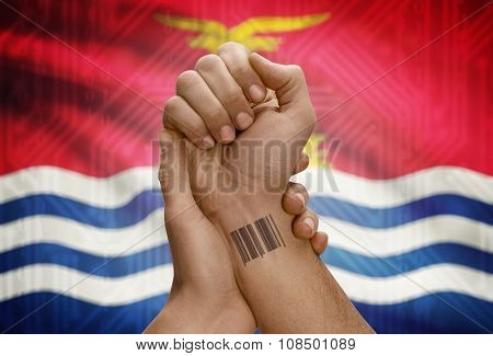 Barcode Id Number On Wrist Of Dark Skinned Person And National Flag On Background - Kiribati