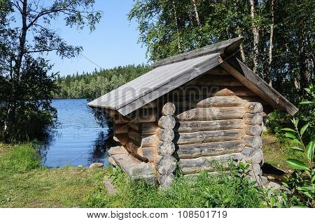 Small Wooden Cabin On The Lake Bank