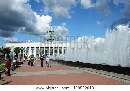 People Walking Near The Big Fountain In St. Petersburg, Sunny Summer Day