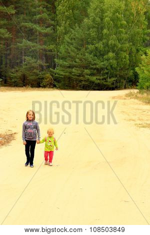 Little Sisters Go On A Forest Road