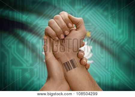 Barcode Id Number On Wrist Of Dark Skinned Person And National Flag On Background - Macau