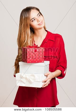 Beautiful Young Woman With Gift Boxes.