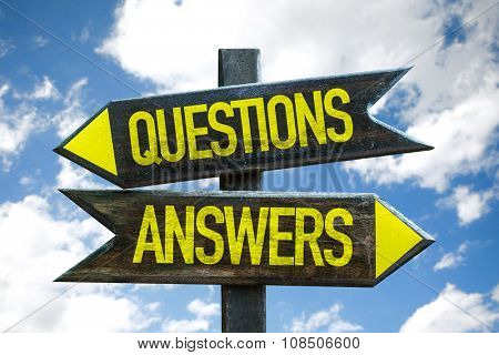 Questions Answers signpost with sky background