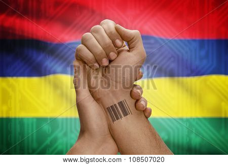 Barcode Id Number On Wrist Of Dark Skinned Person And National Flag On Background - Mauritius