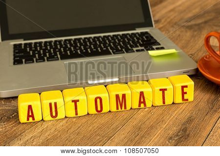 Automate written on a wooden cube in a office desk