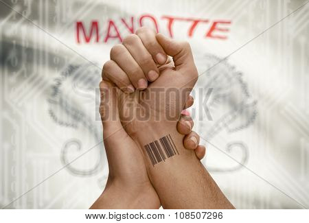 Barcode Id Number On Wrist Of Dark Skinned Person And National Flag On Background - Mayotte