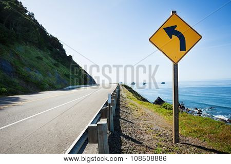 California, Pacific ocean US 101 with arrow sign