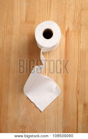 toilet roll on the wooden background