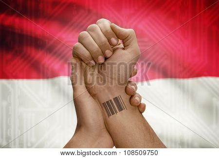 Barcode Id Number On Wrist Of Dark Skinned Person And National Flag On Background - Monaco