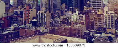 Panoramic View of Low Rise Rooftops and Skyscrapers in New York City, New York, USA with Sepia Toned Filter for Vintage Feel