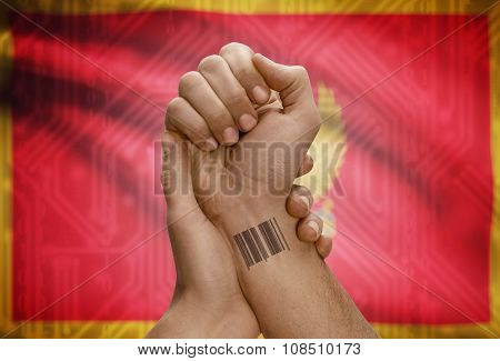 Barcode Id Number On Wrist Of Dark Skinned Person And National Flag On Background - Montenegro