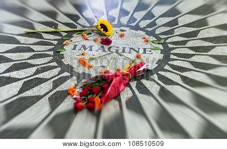 Selective Focus of Rose Bouquet and Flowers Strewn Across Surface of John Lennon Imagine Mosaic in Memorium, Strawberry Fields Area of Central Park, New York City, New York, USA