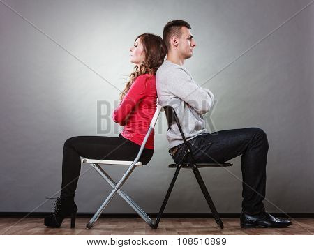 Unhappy Couple Sitting Back To Back. Disagreement.