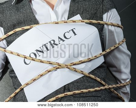 Closeup Of Businesswoman Bound By Contract Terms.