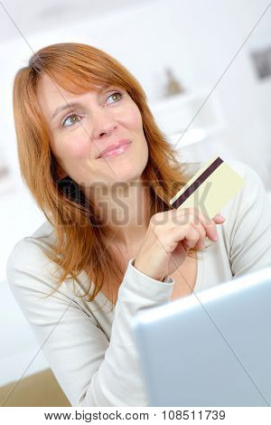 Woman thinking about shopping on-line
