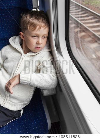 Boy Looking Out Train Window