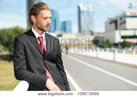 Portrait of an handsome businessman on the road