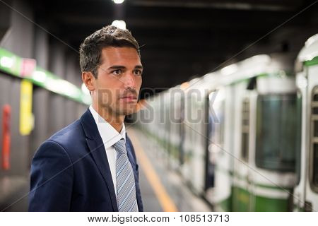 Portrait of a businessman waiting for the subway train