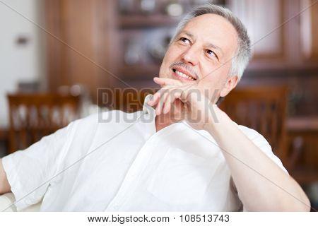 Senior man sitting on the sofa