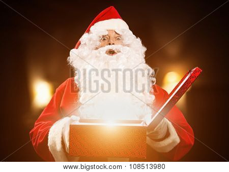 Santa Claus opening a magic gift