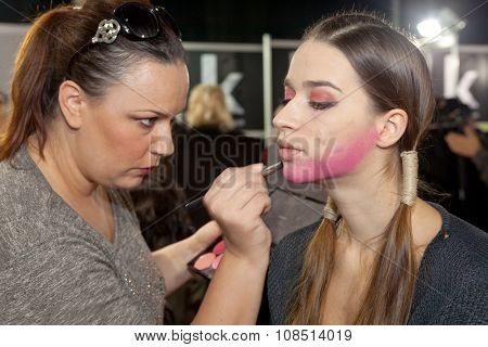 ZAGREB, CROATIA - OCTOBER 31, 2015: Fashion model undergoing makeup process in backstage for Couture show by Marina Design on the 'Fashion.hr' fashion show