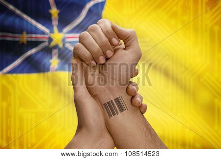 Barcode Id Number On Wrist Of Dark Skinned Person And National Flag On Background - Niue