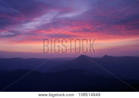 Mountain landscape with the beautiful sky and clouds at sunrise. Carpathians, Ukraine, Europe
