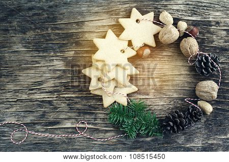 Christmas Wreath Made From Cookies, Nuts, Pine Cones And Fir Branches On Wooden Background