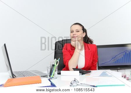 Pretty Business Woman Analyzing Investment Charts With Calculator And Laptop