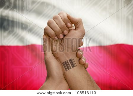 Barcode Id Number On Wrist Of Dark Skinned Person And National Flag On Background - Poland