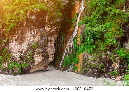 Beautiful mountains landscape with waterfall and river in Nepal, Annapurna trekking