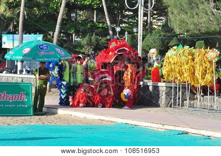 Nha Trang Vietnam - July 14 2015: Young boys are performing the lion dance on the beach of Nha Trang